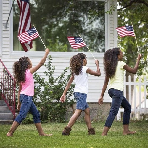 Three girls with American flags