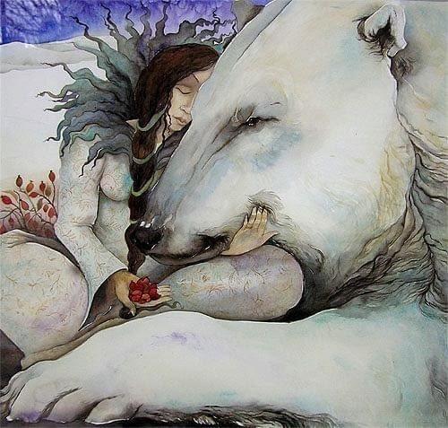 woman hugs polar bear